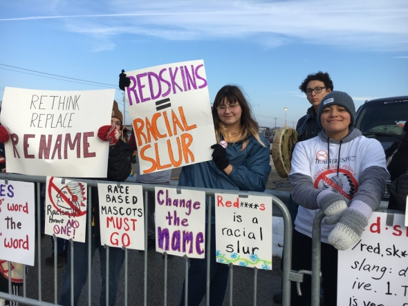 Isabella Saiz, 14, and her friends protest the name and mascot of Washington's NFL team outside Lambeau Field in Green Bay on Sunday, Dec. 8, 2019. Photo by Megan Hart/WPR.