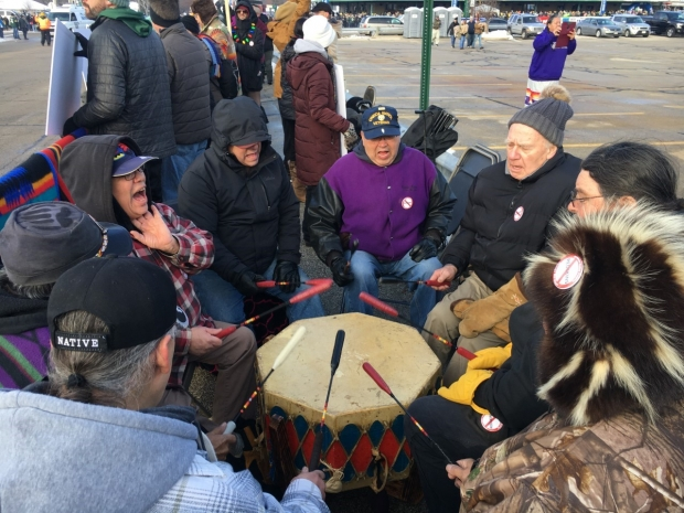 A group drummed Sunday, Dec. 8. 2019, during a protest against the mascot of Washington's NFL team at Lambeau Field in Green Bay. Photo by Megan Hart/WPR.