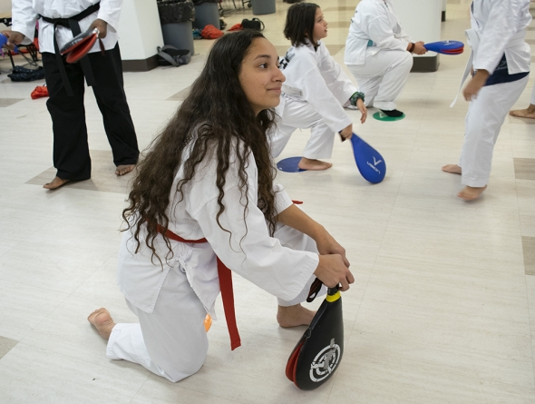 Yanelly Lopez, 15, will test for her high red belt in December and her black belt in June. Currently, she's employed by the same organization that taught her Taekwondo three years ago at Seeds of Health Elementary School in Milwaukee. Photo by Liz Dohms/WPR.