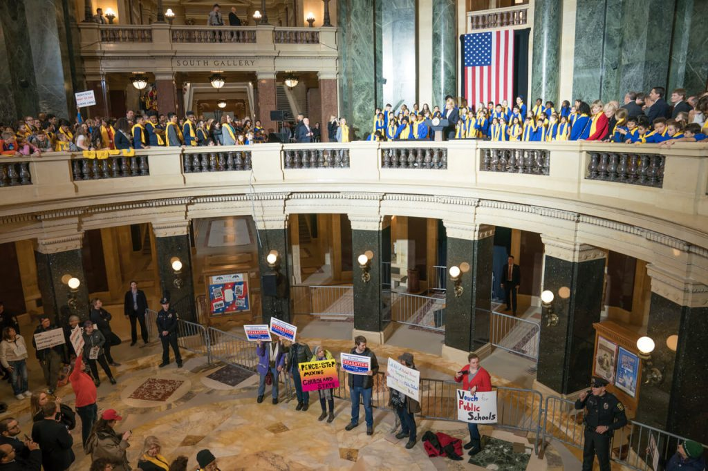 Education Secretary Betsy DeVos speaks at the Capitol in Madison, Wisconsin during School Choice Week as protesters gather in the rotunda below. Photo by Luther Wu/Wisconsin Examiner.