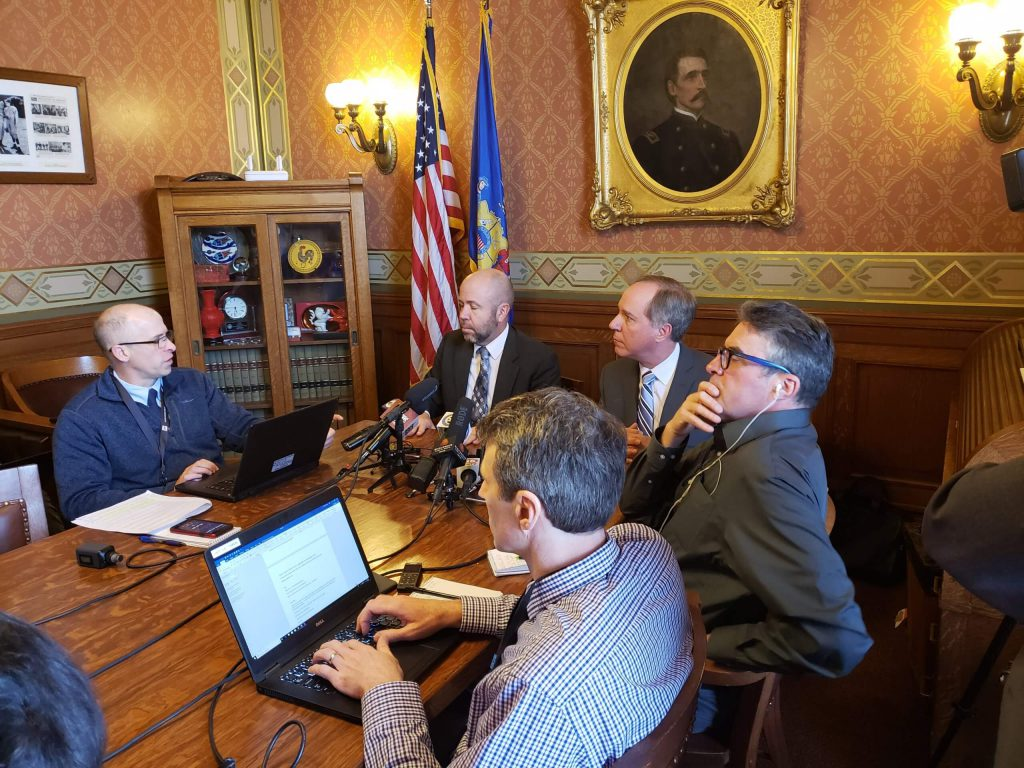 At the head of the table, Majority Leader Rep. Jim Steineke (R-Kaukauna), left, and Speaker Robin Vos (R-Rochester) speak with reporters before Wednesday's Assembly floor session. Photo by Erik Gunn/Wisconsin Examiner.