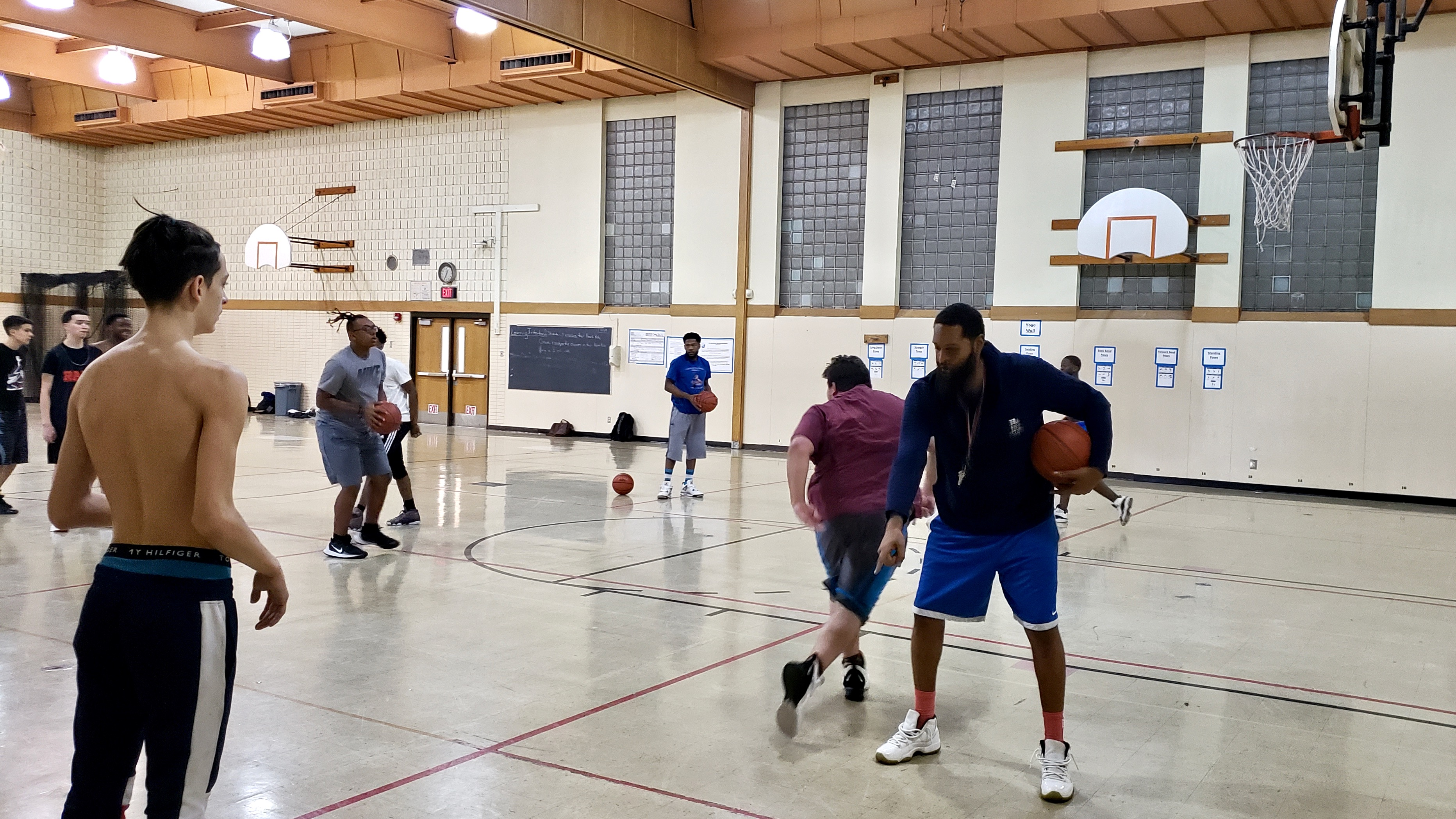 """""""We're not just trying to make them better players, we're trying to make them better people,"""" Pulaski/Carmen Southeast High School varsity basketball coach Melvin White says. Photo by Edgar Mendez/NNS."""