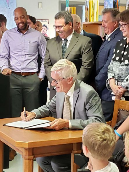 Gov. Tony Evers signing an executive order earlier this year. Photo by Ruth Conniff/Wisconsin Examiner.