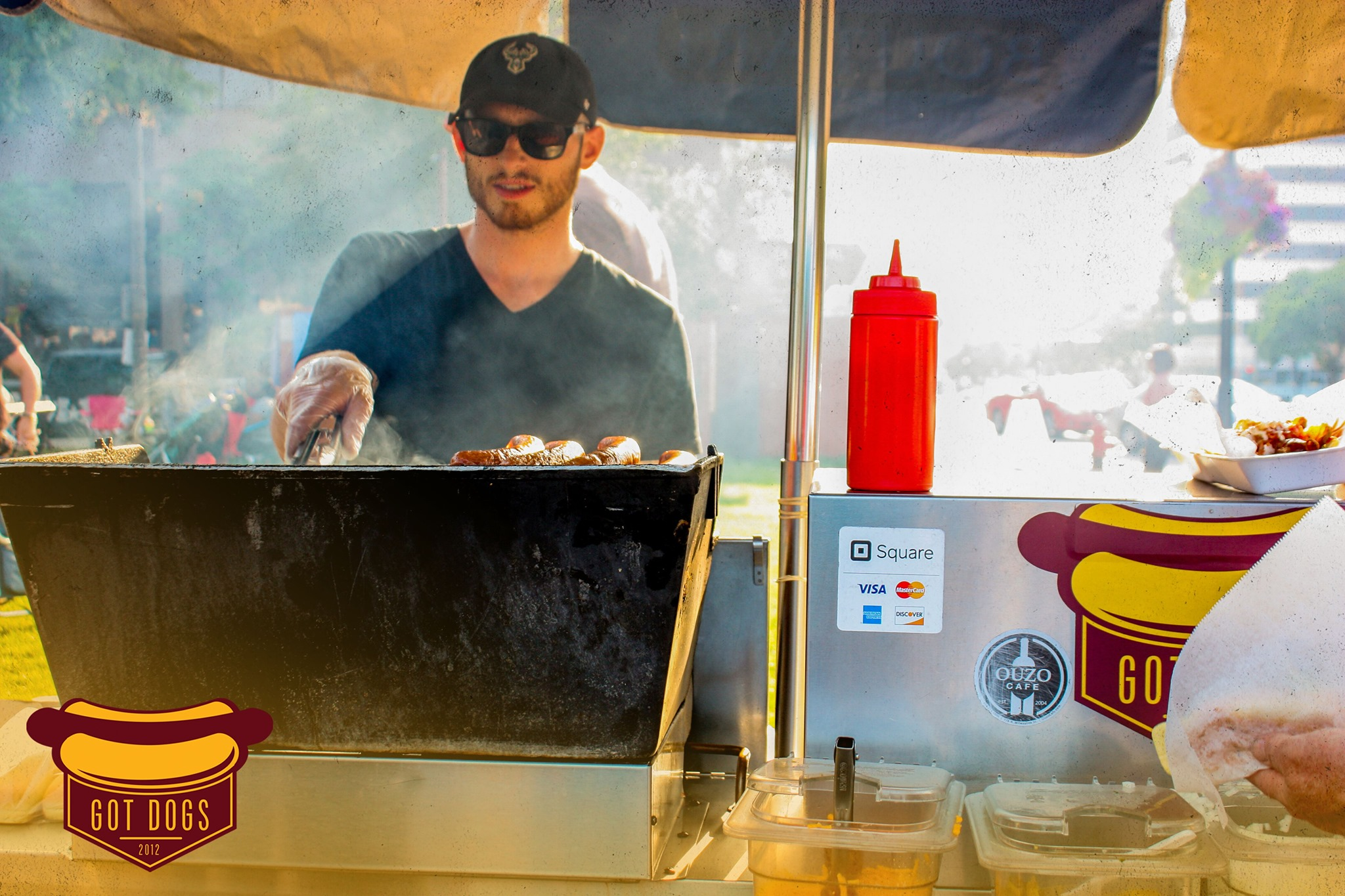 Tom Pappas behind the grill. Photo from Got Dogs.