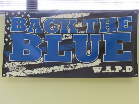 """A 'Black The Blue' banner hung during the press conference. Photo by Isiah Holmes/Wisconsin Examiner."