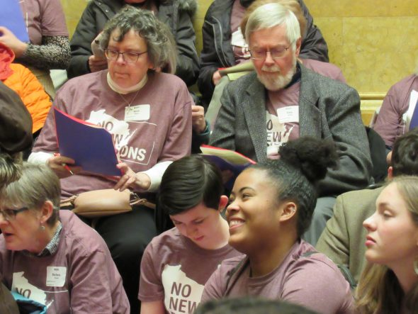 Lobby volunteers listen to instructions during a training session. Photo by Isiah Holmes/Wisconsin Examiner.