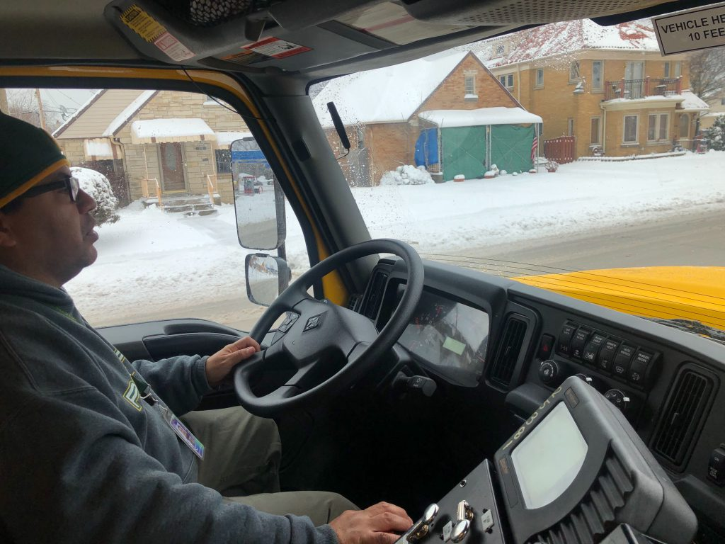 Nabor Trujillo operates a city salt truck. Photo by Jeramey Jannene.