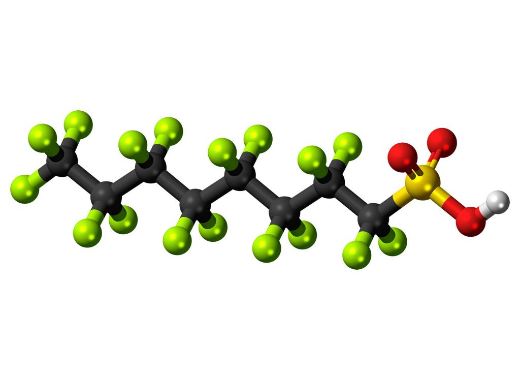 A ball-and-stick model depicts the perfluorooctanesulfonic acid molecule, also known as PFOS. By Jynto (CC0 1.0 Universal Public Domain Dedication).