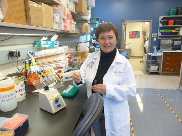 Shown in her lab at the Medical College of Wisconsin in this Nov. 2019 photo, pharmacology professor Cecilia Hillard explains how cannabidiol may be good for inflammation. But she is concerned that too many health claims are untested as CBD products grow in popularity. Photo by Shamane MIlls/WPR.