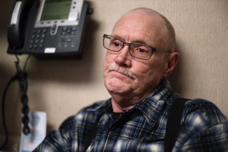 "Michael Kruchten, 62, is a patient of Dr. Angela Gatzke-Plamann who takes prescription opioids for chronic pain. ""Dr. Gatzke has been a big plus and incentive for me. I give her lots of credit. She's one of the main factors why I'm still here. She pulled me through it,"" he says. He is seen at the Necedah Family Medical Center in Necedah, Wis., on November 7. Photo by Coburn Dukehart/Wisconsin Watch."