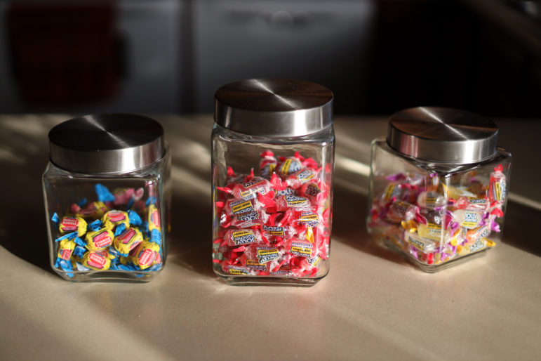 "Canisters of Jolly Rancher candies and bubble gum are seen at the home of Catina Stoflet in Wisconsin Rapids, Wis. Stoflet takes her Suboxone with candy to mask the taste, which she describes as ""horrendous"" and says it ""reminds me of gasoline. But it's worth it."" Photo by Coburn Dukehart/Wisconsin Watch."