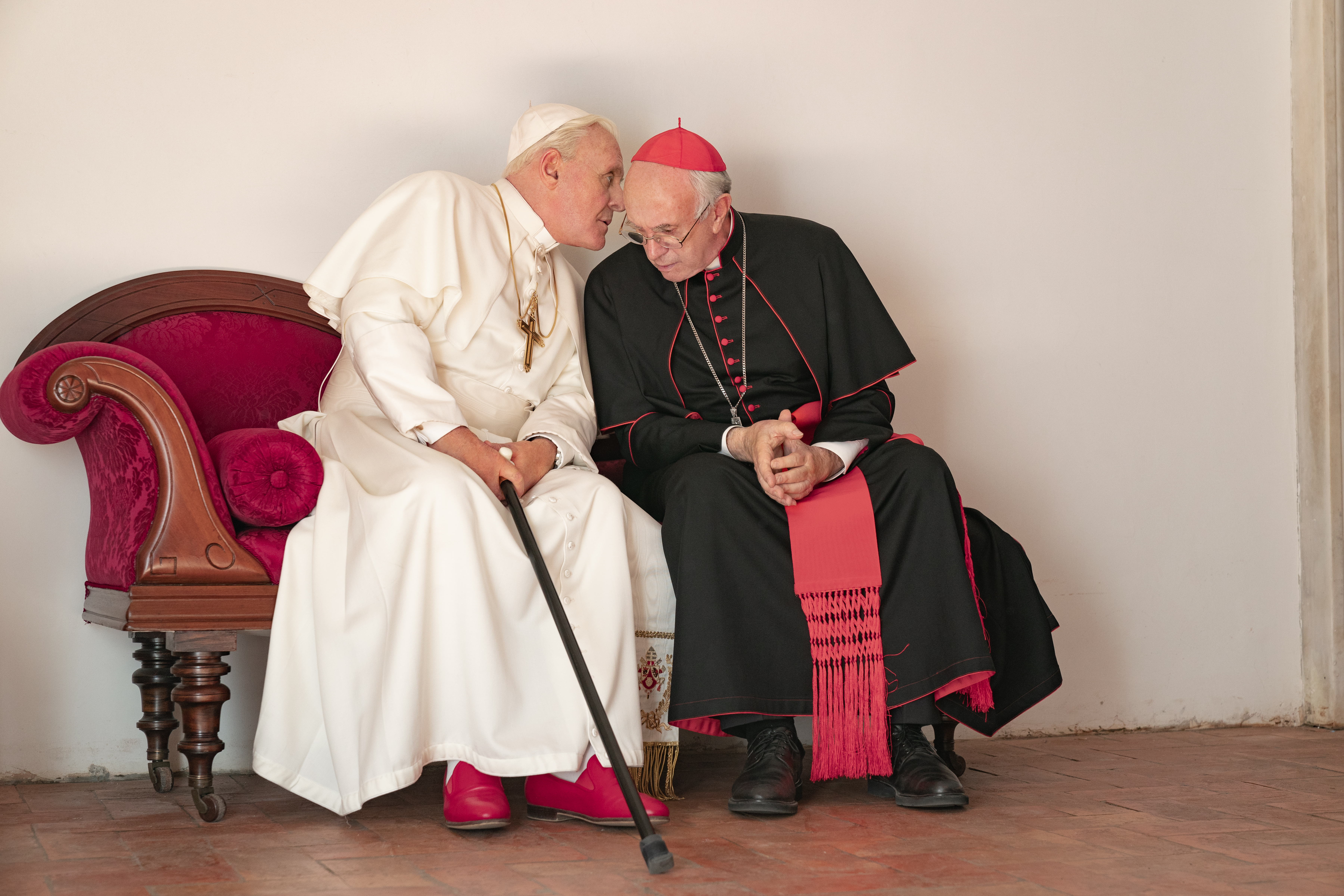 Anthony Hopkins and Jonathan Pryce in 'The Two Popes.' Photo by Peter Mountain.