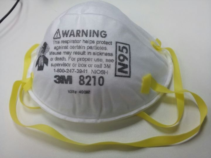 The N95 style medical mask provides a higher level of protection than the more common tissue or cloth surgical mask. Photo by Banej [CC BY-SA (https://creativecommons.org/licenses/by-sa/3.0)].