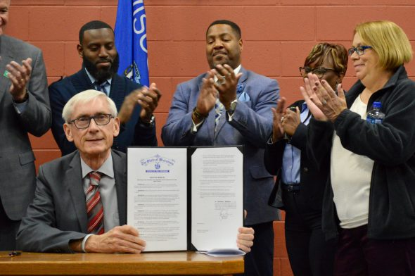 Gov. Tony Evers signs an executive order for a Complete Count Committee for the 2020 census. Photo by Ana Martinez-Ortiz/NNS.