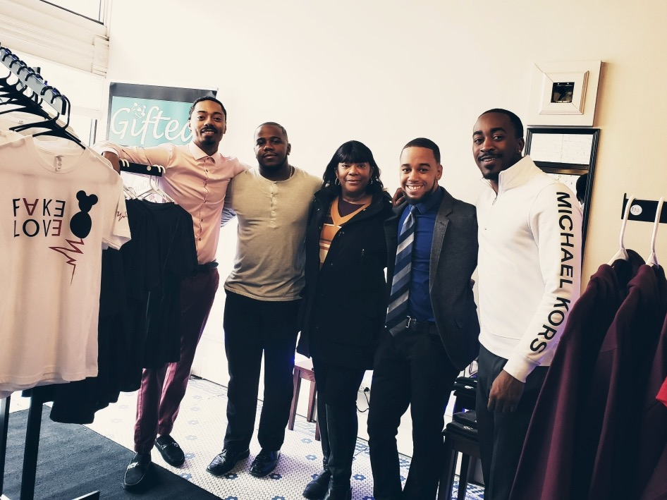JaVaughn Porter (from left), Jamaal Hayes, Carlton LeRoy and Javonte Davis pose with friend Tai Words in their new store. The four men became friends while attending Messmer High School. Photo from Gifted Clothing/NNS.