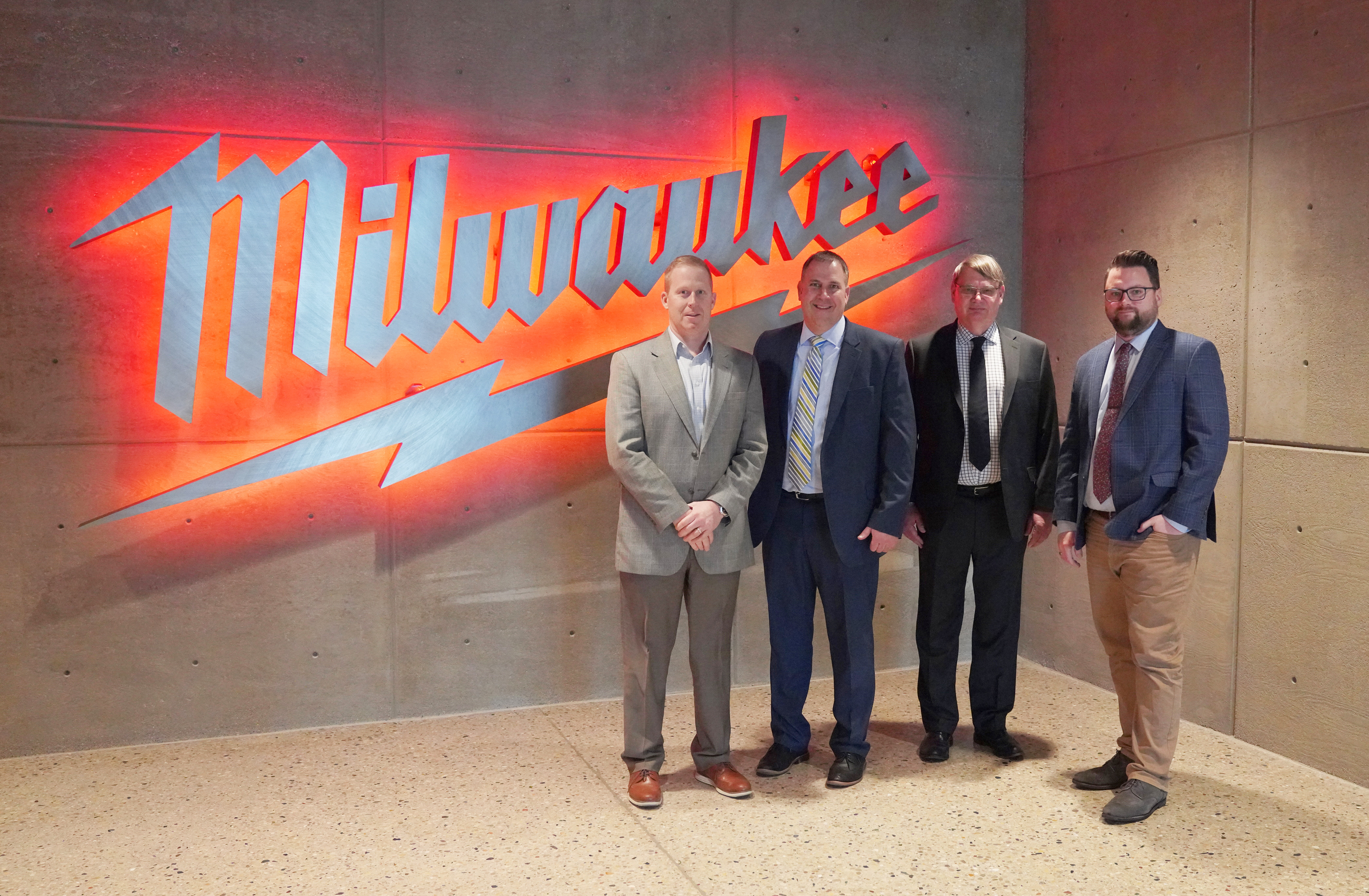 Milwaukee Tool CFO Ty Staviski with City of West Bend Administrator Jay Shambeau, Development Director Mark Piotrowicz, and Economic Development Manager Adam Gitter at Milwaukee Tool's Global Headquarters in Brookfield. Photo courtesy of the City of West Bend.