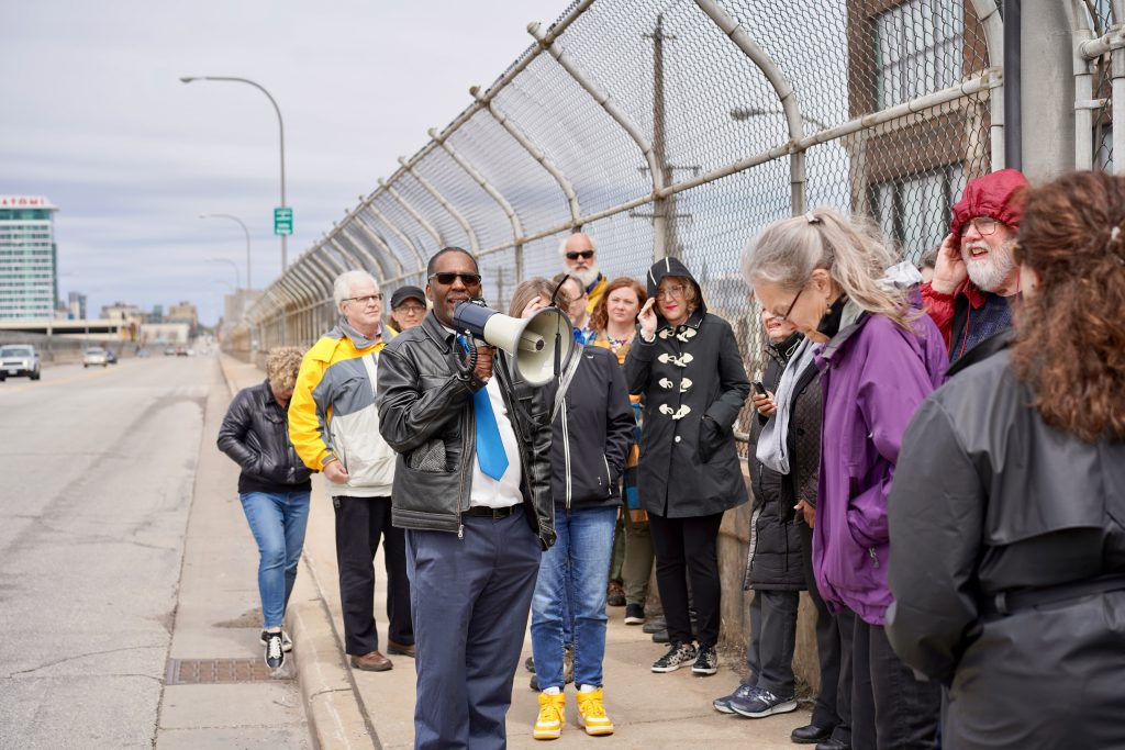 Reggie Jackson discusses the history of Milwaukee's Open Housing marches on the 16th Street Viaduct. Photo by Adam Carr/NNS.