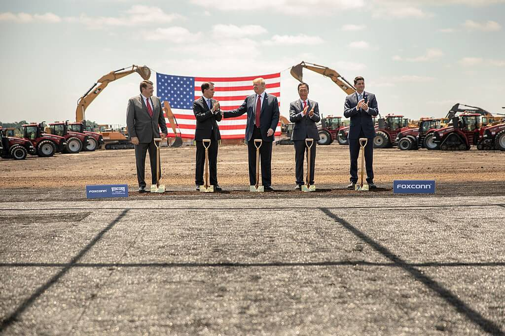 Foxconn's groundbreaking ceremony in Wisconsin in June 2018, brought out then-U.S. House Speaker Paul Ryan, President Donald Trump, then-Gov. Scott Walker, Foxconn Founder and CEO Terry Gou and Christopher Murdock. The company can receive cash payments from the state because it has other refundable tax credits. It has no taxes to reduce because a manufacturing tax credit virtually eliminated them. Photo from the White House.