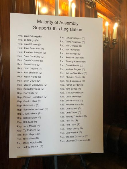 A list of the sponsors of the original bipartisan bill AB 214 displayed at a news conference on rape kit backlog elimination. Photo by Melanie Conklin/Wisconsin Examiner.