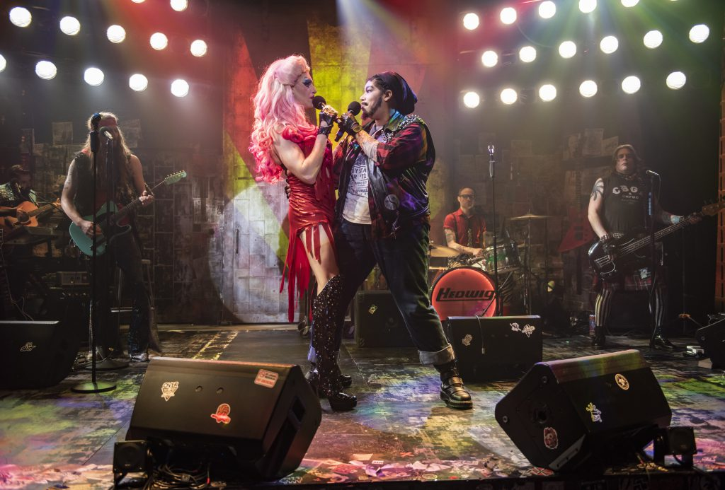 Milwaukee Repertory Theater presents Hedwig and the Angry Inch in the Stiemke Studio January 28 – March 8, 2020. Left to right: Matt Rodin and Bethany Thomas with the company of Hedwig and the Angry Inch. Photo by Michael Brosilow.