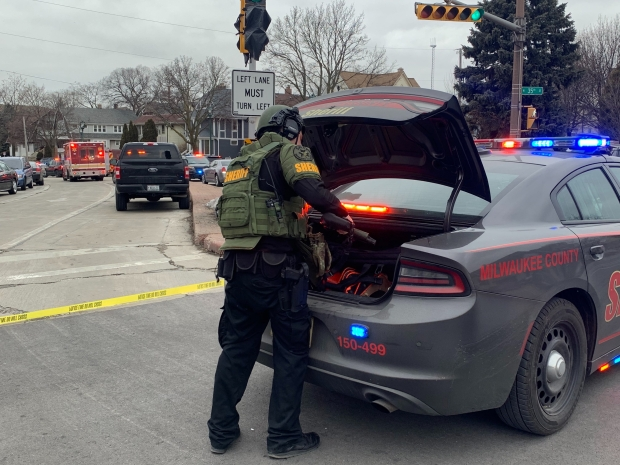 A Milwaukee County Sheriff's Office deputy blocks traffic at North 35th and West State streets after the report of an active shooter at MolsonCoors, 3939 W. Highland Blvd., Milwaukee, Wis. Photo by Alana Watson/WPR.
