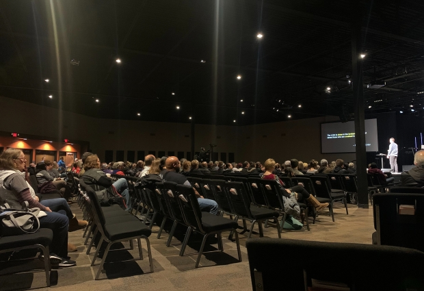 Ridge Community Church lead pastor Mark Weigt led a vigil Thursday, Feb. 27, 2020 to pray for the Molson Coors community after a shooting left five people, and the gunman dead. Photo by Alana Watson/WPR.