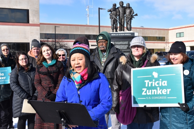 Ka Lo, a member of the Marathon County Board in Wausau, spoke about the Trump administration's immigration policies at a Feb. 13 rally in the city. Photo by Rob Mentzer/WPR.