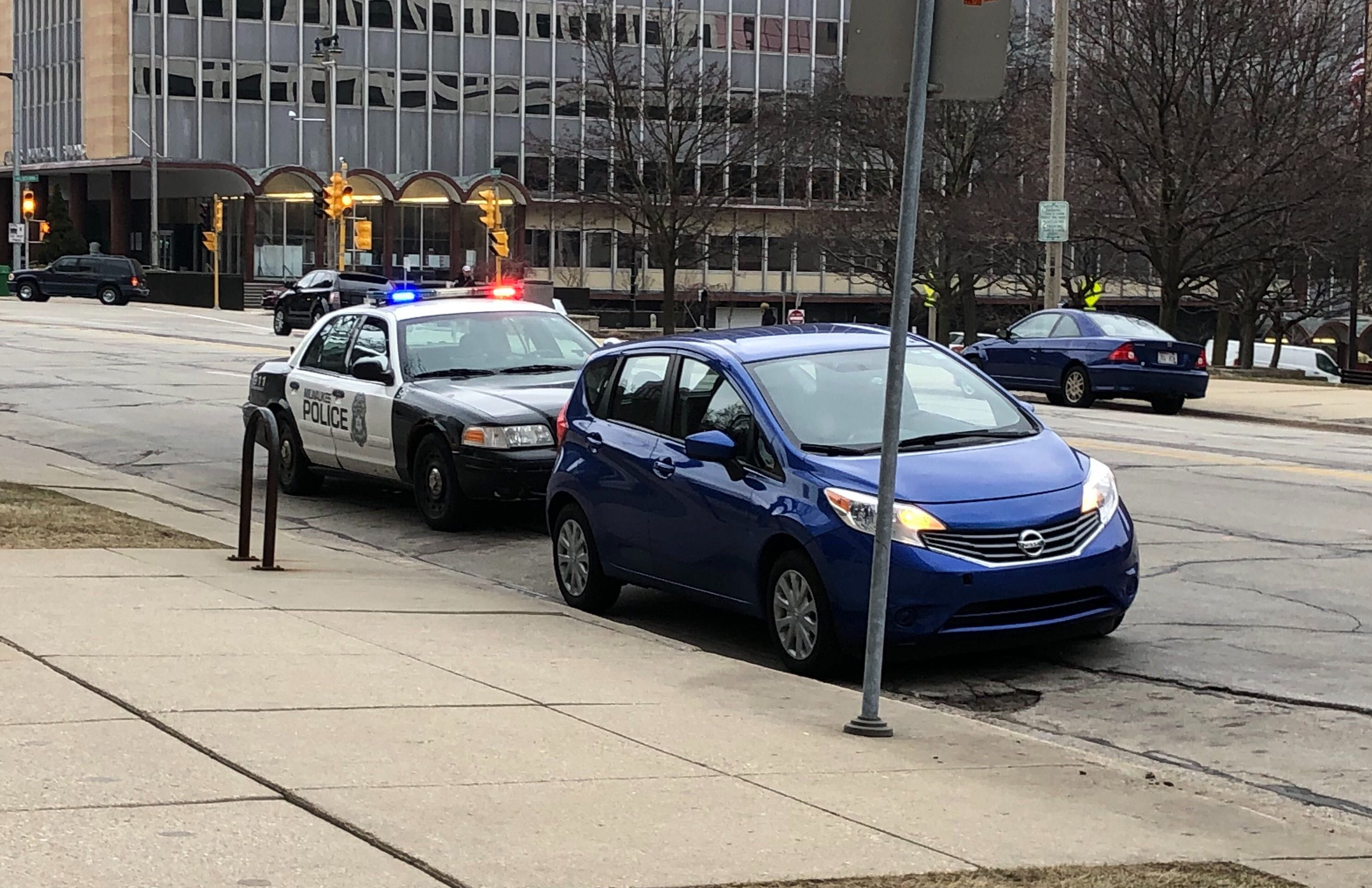 A Milwaukee Police Department officer pulls over a driver on N. Broadway. Photo by Jeramey Jannene.