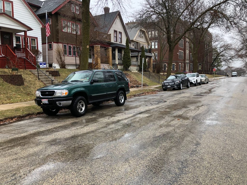 Cars parked along a street in Bay View. Photo by Jeramey Jannene.