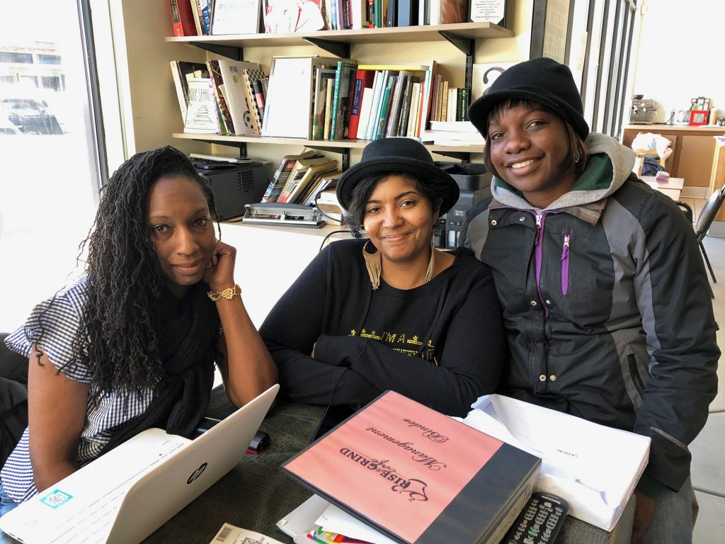 Larina Hightower, left, Baboonie Tatum, center, and Nieisha Riseling, right, said they are surprised the Wisconsin GOP opened an office on King Drive in Milwaukee. Hightower, one of the owners of Rise and Grind Cafe in Milwaukee said it must be a sign the black vote is important, so she said she plans on using her vote wisely. Photo by Corrinne Hess/WPR.