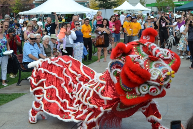 Visitors to the first International Wisconsin Ginseng Festival are welcomed to downtown Wausau by the traditional Chinese lion dance. Photo by Glen Moberg/WPR.