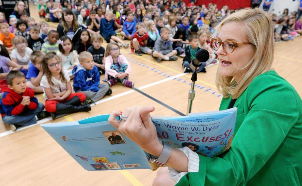 State Treasurer Sarah Godlewski reads to elementary school students in Eau Claire. Photo courtesy of the Wisconsin Office of the State Treasurer.