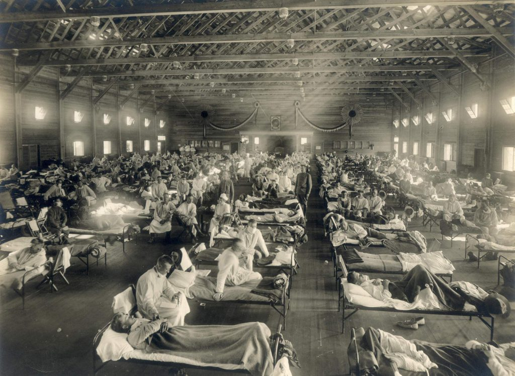 Influenza patients fill beds in an emergency hospital located at Camp Funston, a U.S. Army training camp in Kansas, during the 1918-19 influenza pandemic. National Museum of Health and Medicine (pubilc domain).