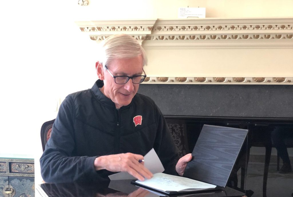 Gov. Evers signing Assembly Bill 1038, now 2019 Wisconsin Act 185. Photo courtesy of the Governor's office.