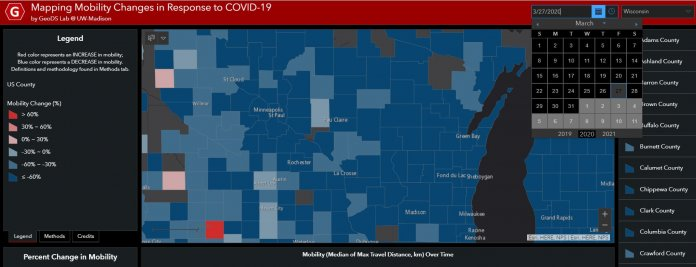 This map shows changes in mobility county by county in Wisconsin on March 27. The red and pink areas indicate greater movement on that date compared with the baseline in late February. Screenshot from Mapping Mobility Changes in Response to COVID-19 by GeoDS Lab @ UW-Madison.