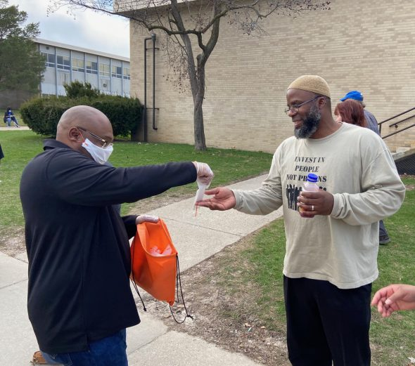 Hamid Abd-Al-Jabbar (left), a violence interrupter and outreach worker at 414 Life, helped distribute 1,500 masks Election Day. Photo provided by Reggie Moore, City of Milwaukee Office of Violence Prevention/NNS.