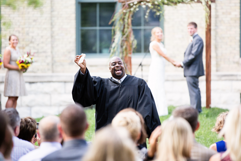Judge Derek Mosley officiating a wedding in 2016. Photo by Ellagraph Studios.