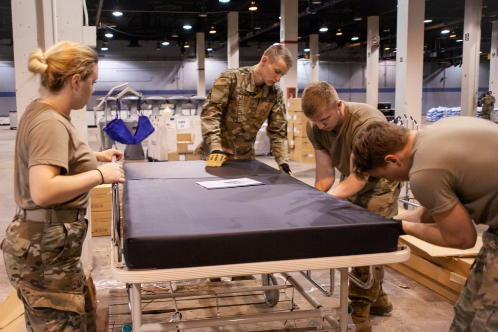 Hospital bed being setup in McCormick Place. U.S. Air Force Photo by Senior Airman Jay Grabiec