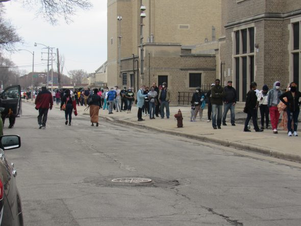 Voters wait in line at Washington High School. Photo by Isiah Holmes/Wisconsin Examiner.