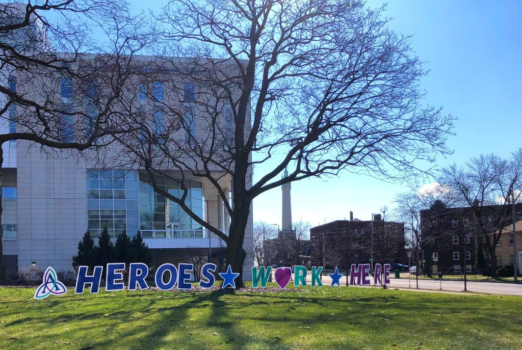 """Heros work here,"" reads the sign in front of Ascension Columbia St. Mary's Hospital. Photo by Dave Reid."