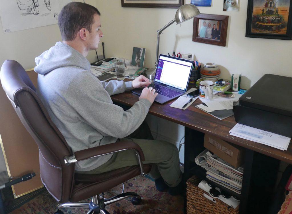 Reporter Graham Kilmer working on a story for Urban Milwaukee.