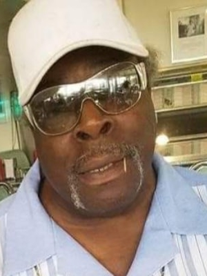 Jerald Coleman, 71, died from complications of COVID-19. Adrienne Lathan described her father as a family man. He was also a veteran of the Vietnam War. Photo courtesy of Adrienne Lathan/WPR.