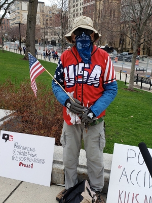 Protester Mickey Bitsko participated in a rally against Wisconsin's stay-at-home order at the Wisconsin State Capitol Building on April 24, 2020. Shawn Johnson/WPR