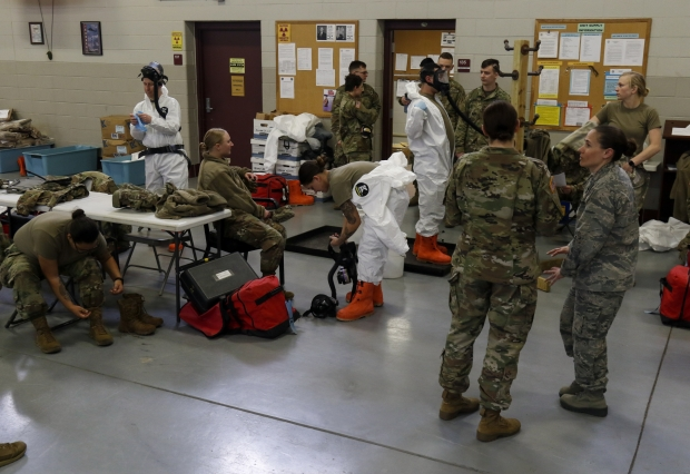 Wisconsin National Guard Soldiers and Airmen practice safely putting on, washing and taking off protective gear as part of preparatory training in Whitewater on March 20, 2020. Photo by Spc. Emma Anderson/Wisconsin National Guard.