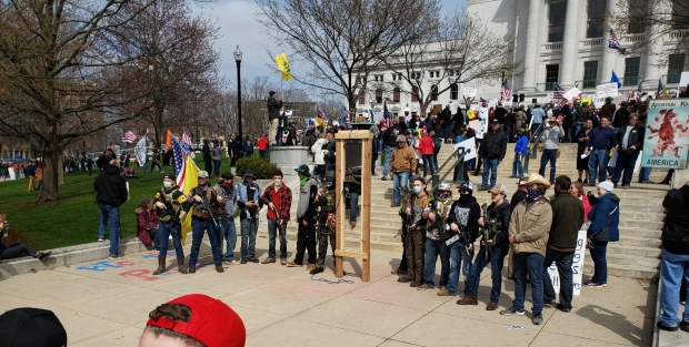 Some protesters carried assault rifles at a rally against Wisconsin's stay-at-home order at the Wisconsin Capitol on April 24, 2020. Shawn Johnson/WPR