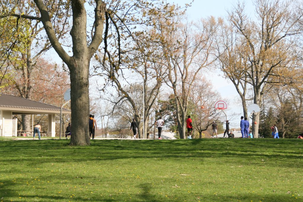 Individuals playing basketball at Kern Park on May 15th. Photo by Jeramey Jannene.