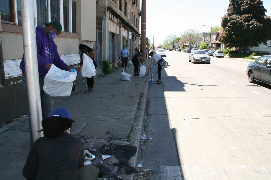 Milwaukeeans clean up the streets. Photo by Jeramey Jannene.