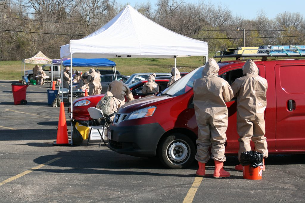 Wisconsin National Guard assist individuals in performing COVID-19 specimen collections at a drive-thru testing site. Photo by Jeramey Jannene.