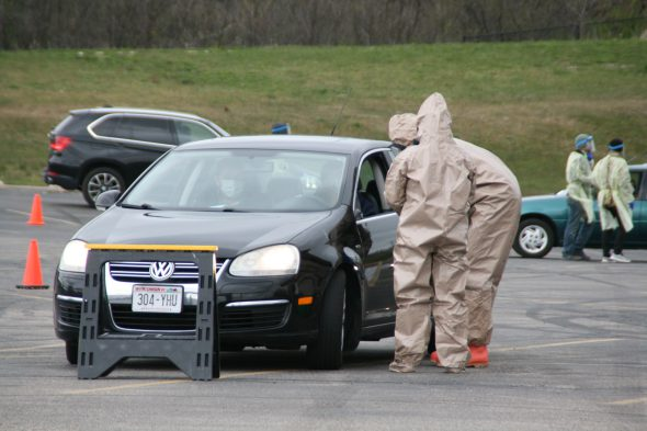 Wisconsin National Guard individuals man a COVID-19 testing facility in Bay View. Photo by Jeramey Jannene.