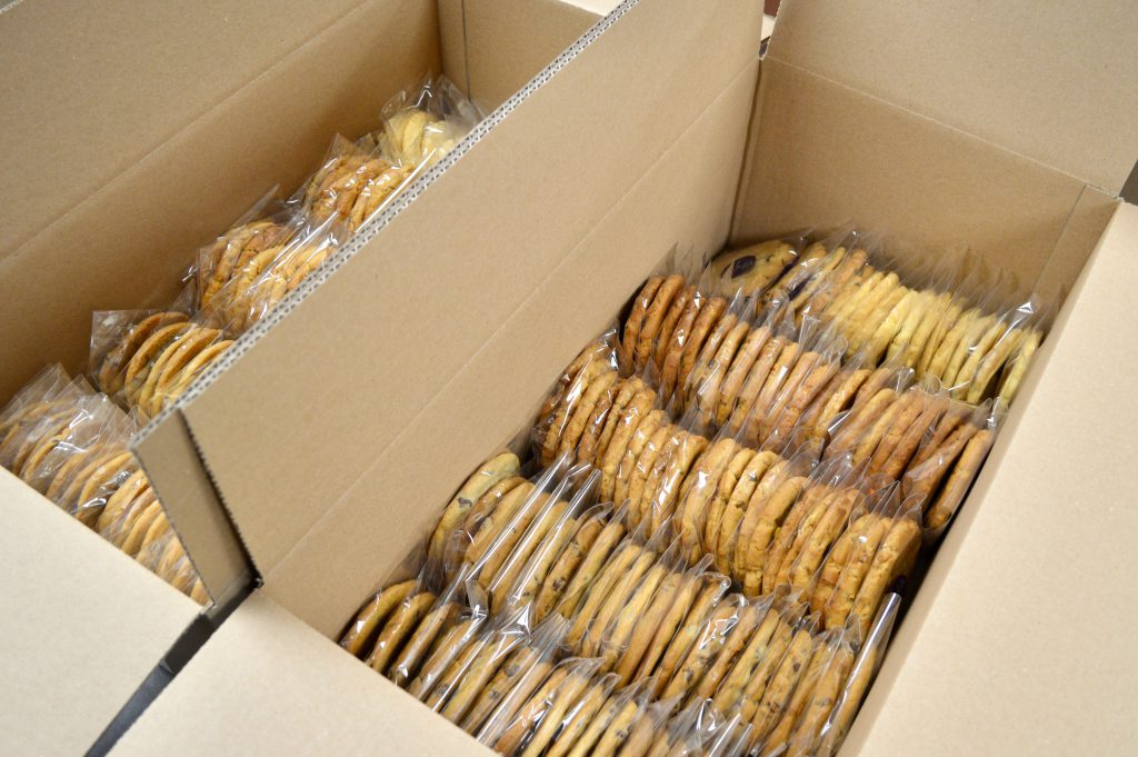 Each box contains three types of cookies and messages of positivity. Photo by Ana Martinez-Ortiz/NNS.